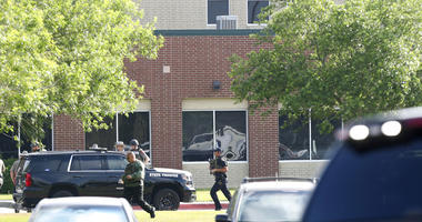 In this May 18, 2018, file photo, law enforcement officers respond to Santa Fe High School after an active shooter was reported on campus in Santa Fe, Texas.