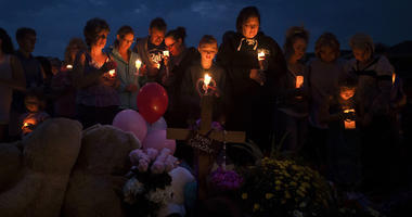 Mourners gather in front of a memorial for a candle-lit vigil for Shanann Watts and her two daughters, Bella, 4, and Celeste, 3, in front of the Watts' home on Friday, Aug. 17, 2018, in Frederick, Colo.