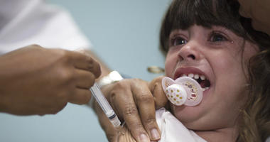 In this file photo dated Monday, Aug. 6, 2018, a child receives a measles vaccination in Rio de Janeiro, Brazil.