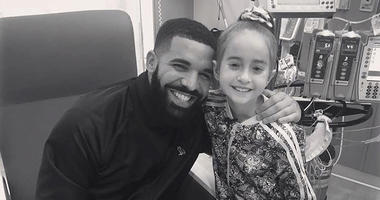 This Monday, Aug, 20, 2018 photo provided by the rapper Drake shows him posing with Sofia Sanchez, at Lurie Children's Hospital in Chicago.