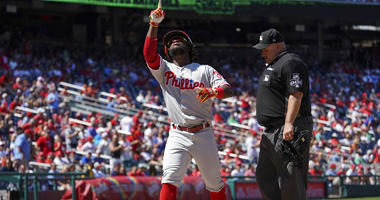 Philadelphia Phillies center fielder Odubel Herrera (37) points to the sky as he crosses home plate after hitting a two run home run in the seventh inning against the Washington Nationals.