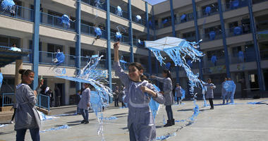 """In this March 12, 2018, file photo, refugee school girls fly kites during the """"Kites of Dignity"""" event at the UNRWA Rimal Girls Preparatory school in Gaza City."""