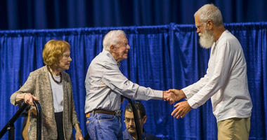 Former late night television host David Letterman, right, welcomes former President Jimmy Carter and his wife, former first lady Rosalynn Carter, to the stage during the opening ceremony for the Jimmy & Rosalynn Carter Work Project.