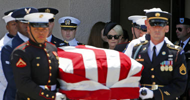 Cindy McCain, back right, walks with her son Jack McCain, back left, as the follow the military honor guard carrying the casket of Sen. John McCain, R-Ariz., after a memorial service at North Phoenix Baptist Church.