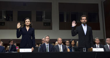 Facebook COO Sheryl Sandberg, left, accompanied by Twitter CEO Jack Dorsey are sworn in before the Senate Intelligence Committee hearing on 'Foreign Influence Operations and Their Use of Social Media Platforms' on Capitol Hill, Wednesday, Sept. 5, 2018.
