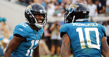 Jacksonville Jaguars wide receiver Dede Westbrook (12) celebrates his 61-yard touchdown against the New England Patriots with teammate wide receiver Donte Moncrief (10) during the second half, Sunday, Sept. 16, 2018, in Jacksonville, Fla.