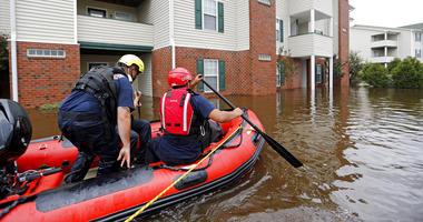 Rescue personnel paddle through a flooded apartment complex to evacuate residents as flooding continues in the aftermath of Hurricane Florence in Spring Lake, N.C., Monday, Sept. 17, 2018.