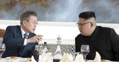 South Korean President Moon Jae-in, left, talks with North Korean leader Kim Jong Un.