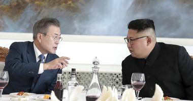South Korean President Moon Jae-in, left, talks with North Korean leader Kim Jong Un.