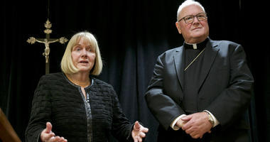 Cardinal Timothy Dolan addresses a news conference at the New York Archdiocese. The Roman Catholic Archdiocese of New York said it has hired former federal judge Barbara Jones, left, to review its procedures for handling allegations of sex abuse.