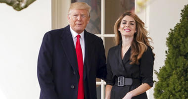 President Donald Trump poses for members of the media with then White House Communications Director Hope Hicks.