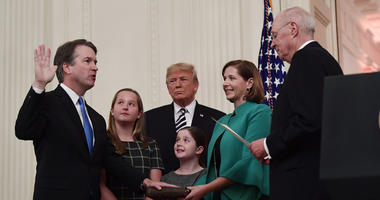 Retired Justice Anthony Kennedy, right, ceremonially swears-in Supreme Court Justice Brett Kavanaugh, as President Donald Trump looks on, in the East Room of the White House in Washington, Monday, Oct. 8, 2018.