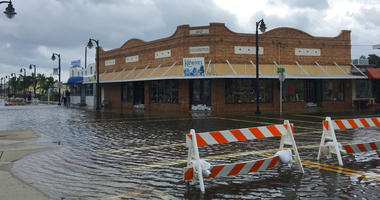 High tide from offshore Hurricane Michael creeps up into the Sponge Docks in Tarpon Springs, Fla., Wednesday, Oct. 10, 2018 after the Anclote River backs up.