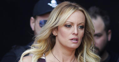 "FILE - In this Thursday, Oct. 11, 2018, file photo, adult film actress Stormy Daniels arrives for the opening of the adult entertainment fair ""Venus,"" in Berlin."