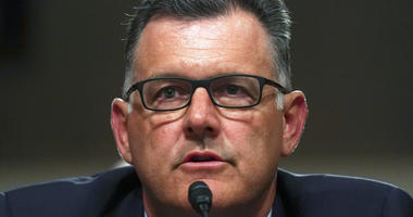FILE - In this Tuesday, June 5, 2018, file photo, former USA Gymnastics president Steve Penny invokes his right under the Fifth Amendment not to answer questions during a Senate Subcommittee on Consumer Protection, Product Safety, Insurance, and Data Secu