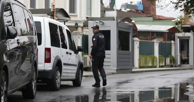A Turkish police officer walks outside the Saudi Arabia consul general residence in Istanbul, Thursday, Oct. 18, 2018.