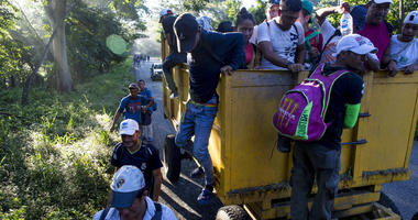 Central American migrants traveling with a caravan to the U.S. make their way to Pijijiapan, Mexico, Thursday, Oct. 25, 2018.