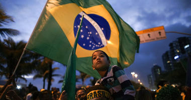 Supporters gather outside the residence of presidential candidate Jair Bolsonaro in anticipation of his victory speech, in Rio de Janeiro, Brazil, Sunday, Oct. 28, 2018.