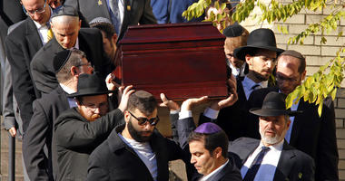 Pallbearers carry the casket of Joyce Fienberg from the Beth Shalom Synagogue following a funeral service in the Squirrel Hill neighborhood of Pittsburgh, Wednesday, Oct. 31, 2018.