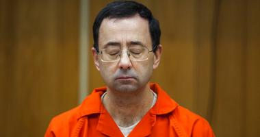FILE - In this Feb. 5, 2018, file photo, Larry Nassar listens during his sentencing at Eaton County Circuit Court in Charlotte, Mich.