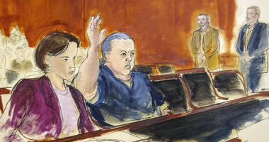 In this courtroom sketch, pipe bombs suspect Cesar Sayoc seated in court, raises his arm to swear to the truth of his statement of need for assigned counsel, during his presentment in Manhattan Federal Court Tuesday, Nov. 6, 2018, in New York.
