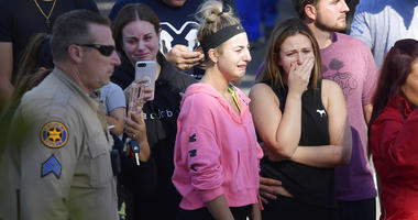 People cry as a law enforcement motorcade escorts the body of Ventura County Sheriff's Department Sgt. Ron Helus from the Los Robles Regional Medical Center.