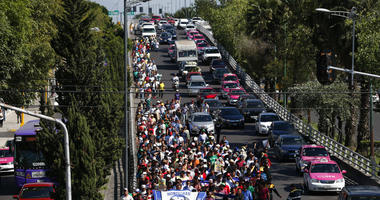 A group of Central American migrants, representing the thousands participating in a caravan trying to reach the U.S. border, undertake an hours-long march to the office of the United Nations' humans rights body in Mexico City, Thursday, Nov. 8, 2018.