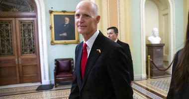 FILE- In this Wednesday, Nov. 14, 2018, file photo Florida Gov. Rick Scott arrives for a meeting with Majority Leader Mitch McConnell, R-Ky., and new GOP senators at the Capitol in Washington.