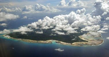 FILE – In this Nov. 14, 2005 file photo, clouds hang over the North Sentinel Island, in India's southeastern Andaman and Nicobar Islands.