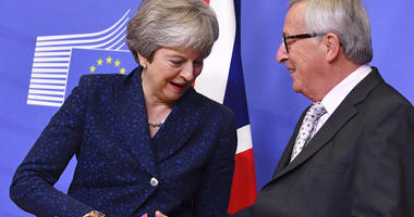 European Commission President Jean-Claude Juncker, right, shakes hands with British Prime Minister Theresa May prior to a meeting at EU headquarters in Brussels, Saturday, Nov. 24, 2018.