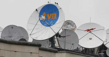 FILE - In this Sept. 12, 2017 file photo, satellite dishes sit on top of the headquarters of the TVN independent and popular TV network in Warsaw, Poland.