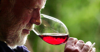 FILE--In this Feb. 23, 2004, file photo, winemaker David Lett savors the bouquet from a glass of Pinot Noir at his Eyrie Vinyards home in Dundee, Ore.