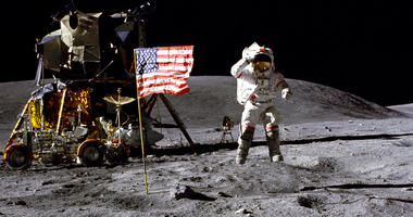 FILE- In this April 1972 photo made available by NASA, John Young salutes the U.S. flag at the Descartes landing site on the moon during the first Apollo 16 extravehicular activity. America's next moon landing will be made by private companies, not NASA