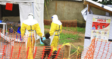 FILE - In this file photo dated Sunday, Sept. 9, 2018, health workers walk with a boy suspected as having the Ebola virus at an Ebola treatment centre in Beni, Eastern Congo.