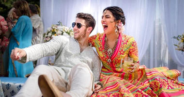 In this Friday, Nov. 30, 2018 handout photo released by Raindrop Media, Bollywood actress Priyanka Chopra and Nick Jonas celebrate during a mehendi ceremony, a day before their wedding, at Umaid Bhawan in Jodhpur, India.