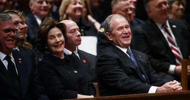 Jeb Bush, Laura Bush, and former President George W. Bush share a laugh as a story is told about former President George H.W. Bush during a State Funeral at the National Cathedral, Wednesday, Dec. 5, 2018, in Washington.
