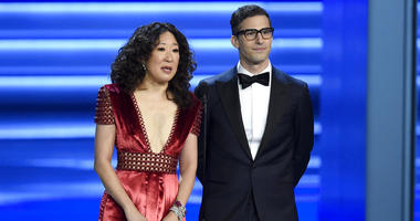 FILE - In this Sept. 17, 2018 file photo, Sandra Oh, left, and Andy Samberg present an award at the 70th Primetime Emmy Awards in Los Angeles.