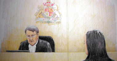 In this courtroom sketch, Meng Wanzhou, right, the chief financial officer of Huawei Technologies, listens to the judge during a bail hearing at B.C. Supreme Court in Vancouver, British Columbia, on Tuesday, Dec. 11, 2018.