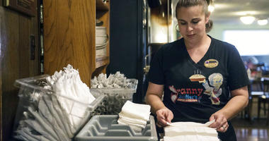 In this Tuesday, Dec. 18, 2018 photo, Shawna Green, waitress at Granny Shaffer's, prepares utensils for customers at the restaurant in Joplin, Mo.