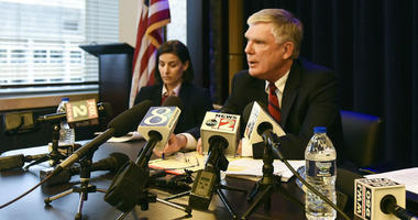 Special counsel Bill Forsyth, right, answers questions, Friday, Dec. 21, 2018, during a press conference in Lansing, Mich., regarding the independent Special Counsel's investigation into Michigan State University's handling of the sexual abuse scandal inv