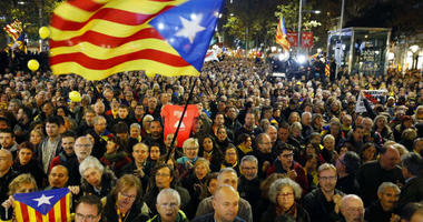 Protesters hold Catalan flags during a rally in Barcelona, Spain, Friday, Dec. 21, 2018.