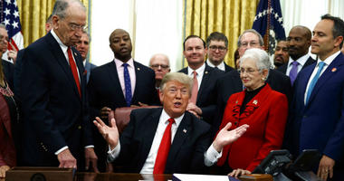 President Donald Trump speaks during a signing ceremony for criminal justice reform legislation in the Oval Office of the White House, Friday, Dec. 21, 2018, in Washington.