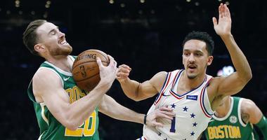Boston Celtics' Gordon Hayward (20) is defended by Philadelphia 76ers' Landry Shamet (1) during the first half of an NBA basketball game in Boston, Tuesday, Dec. 25, 2018.