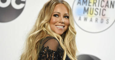 FILE - In this Oct. 9, 2018 file photo, Mariah Carey poses in the press room at the American Music Awards at the Microsoft Theater in Los Angeles.