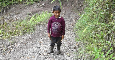 This undated photo provided by Catarina Gomez on Thursday, Dec. 27, 2018, shows her half-brother Felipe Gomez Alonzo, 7, near Laguna Brava in Yalambojoch, Guatemala.