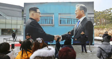 FILE - In this Dec. 13, 2018, file photo, people take pictures of an image of North Korean leader Kim Jong Un, left, and South Korean President Moon Jae-in displayed at a park near the presidential Blue House in Seoul, South Korea