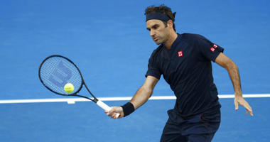 Switzerland's Roger Federer volleys during his match against Britain's Cameron Norrie at the Hopman Cup in Perth, Australia, Sunday Dec. 30, 2018.