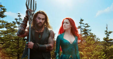"This image released by Warner Bros. Pictures shows Jason Momoa, left, and Amber Heard in a scene from ""Aquaman."""