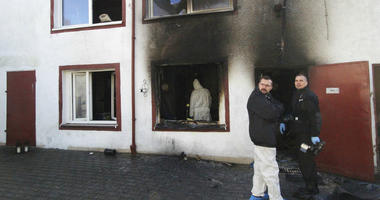 Forensic and other police experts examine the site of a fire in an Escape Room, in Koszalin, northern Poland, on Saturday, Jan. 5, 2019.