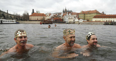 Polar swimmers take part in their traditional Three Kings swim in the Vltava River in Prague, Czech Republic, Sunday, Jan. 6, 2019.